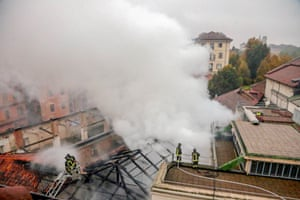 Smoke billows after a fire broke out at dawn at the Unesco heritage site Cavallerizza Reale
