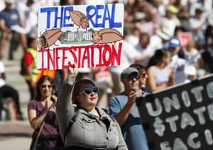 In downtown Denver, a protester references Trump's incendiary rhetoric about immigrants.