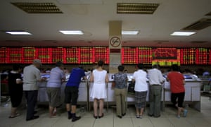 Investors at a brokerage house in Shanghai on Monday.