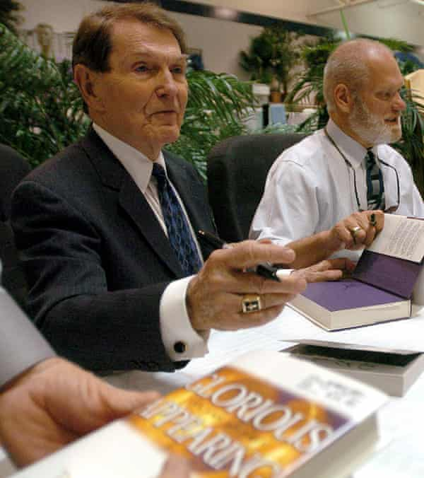 Co-authors Tim LaHaye, left, and Jerry Jenkins sign copies of their book Glorious Appearing.