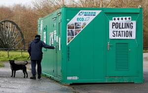 One man and his a dog arrives at a polling station in a container outside the Olympian boxing club in Sunderland