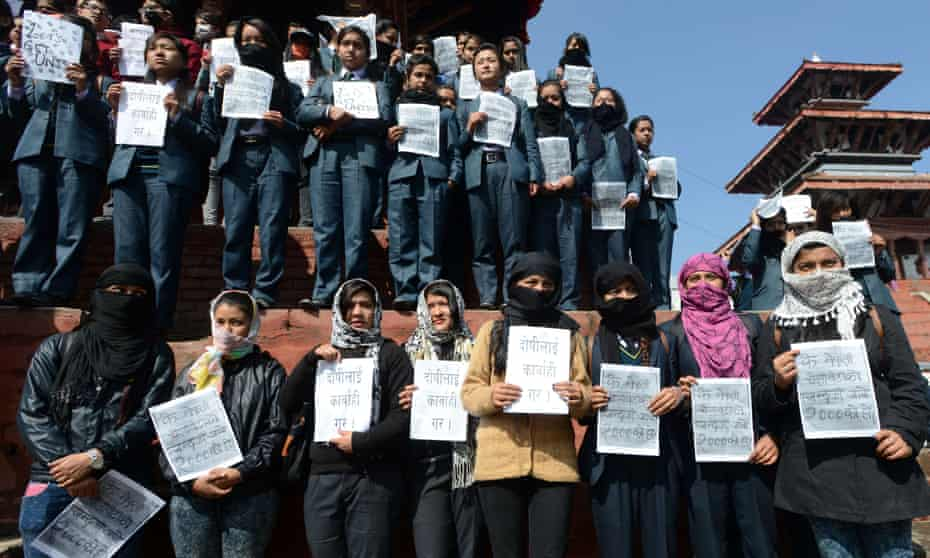 Nepali youth activists hold posters as they take part in a protest against an acid attack on two schoolgirls in Kathmandu.