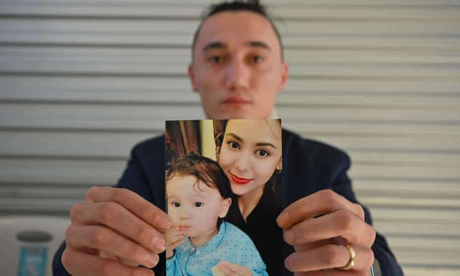 Australian Uighur Sadam Abdusalam holds up a photo of his wife Nadila Wumaier and their baby son Lutifeier. He is trying to get them released from China.
