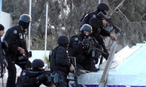Tunisian special forces take position during clashes with militants in Ben Guerdane.
