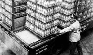 Milkman loading bottles, 1955