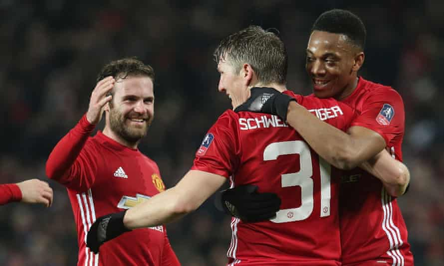 Juan Mata, Bastian Schweinsteiger and Anthony Martial celebrate Manchester United's fourth goal.