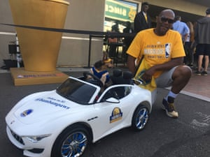 Four-legged fan Bambam sports Warriors gear at the Oracle Arena in Oakland.