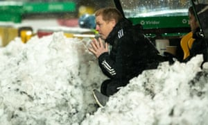 Neil Lennon sits in the snow-covered dugout contemplating Celtic's 2-2 draw at Livingston.
