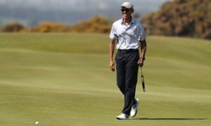 Obama plays a round of golf at St Andrews golf club.