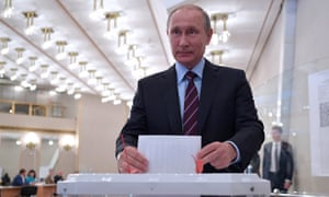 Vladimir Putin casting his ballot at a polling station in the Russian Academy of Sciences.
