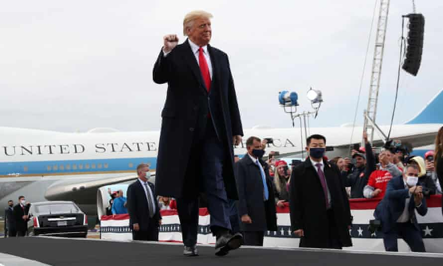Donald Trump arrives for a campaign rally in Londonderry, New Hampshire.