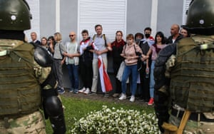 Minsk, Belarus:Opposition supporters form a human chain as they are confronted by riot police during a protest. Since the announcement of the 2020 Belarusian presidential election results on August 9, mass protests against the election results have been erupting in major cities across Belarus