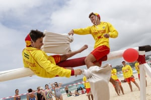 Lifeguards on Bondi beach take part in a pillow fight challenge.