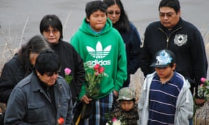 The family of Jordan Wabasse listen to prayers during a memorial service for the teen in 2011. Wabasse is one of seven First Nations students who have died in Thunder Bay, Ontario, between 2000 and 2011.
