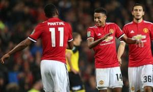 Anthony Martial celebrates Manchester United's fourth against Burton.