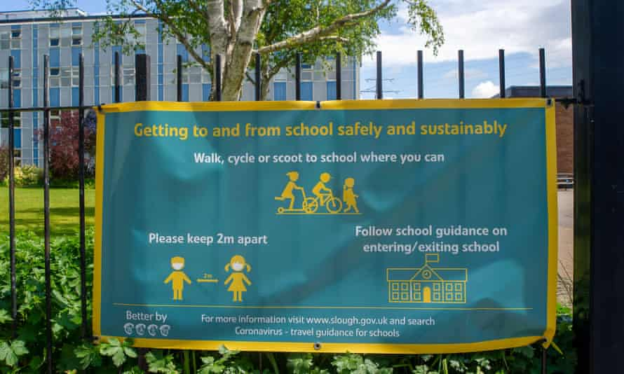 A social distancing sign outside a school in Slough, Berkshire. The mandate on face masks in schools has been lifted.