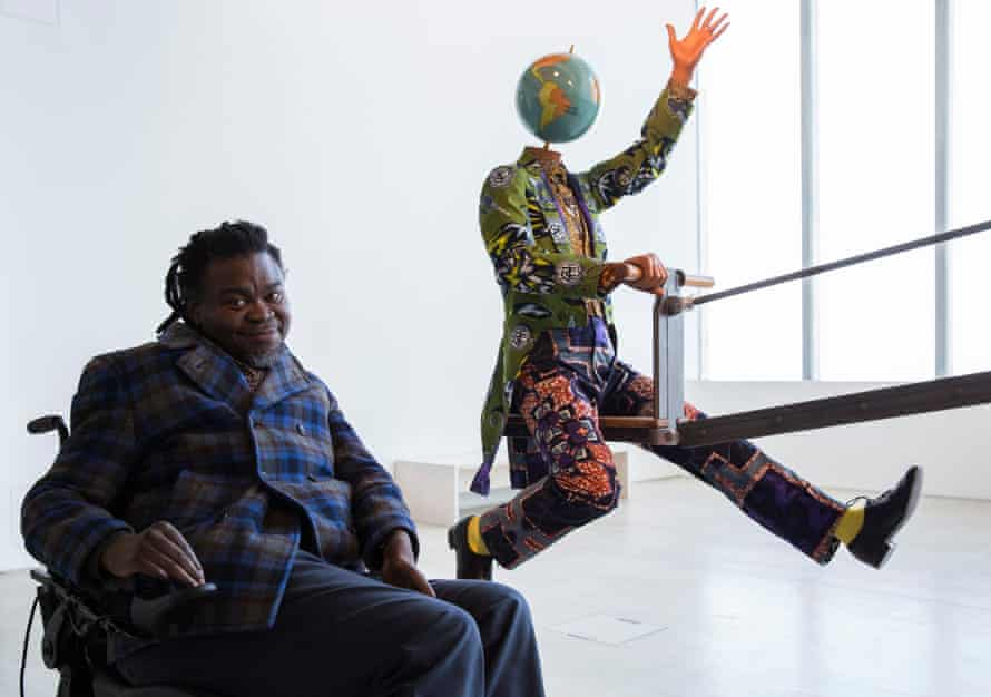 Yinka Shonibare MBE with his work End of Empire.