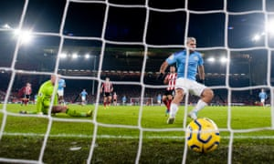 Sergio Aguero follows the ball into the net after scoring from Kevin De Bruyne's cross for Manchester City's winner.