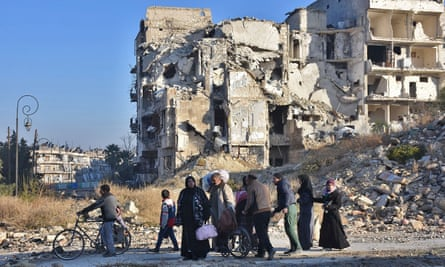Syrian residents fleeing the violence in the eastern rebel-held parts of Aleppo
