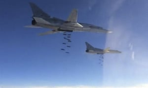 Russian Tupolev TU-22 bombers conduct an air strike in Syria