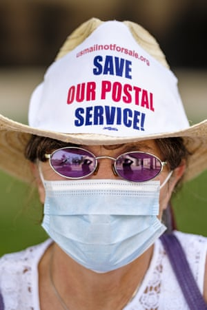 Save The Post Office Rally In Des Moines, Iowa. Julie Backson, a retired postal worker, participates in rally to save the Postal Service at the Neal Smith Federal Building in Des Moines. About 100 people, postal workers and members of the public, came to the Neal Smith Federal Building earlier this month to call for increased spending for the US Postal Service and an end to attacks on the USPS by members of the Trump administration.