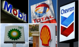 A combination of file photos shows the logos of five of the largest publicly traded oil companies; BP, Chevron, Exxon Mobil, Royal Dutch Shell, and Total.