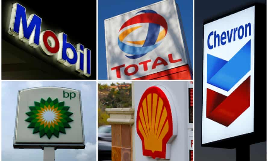A combination of file photos shows the logos of five of the largest publicly traded oil companies - BP, Chevron, ExxonMobil, Royal Dutch Shell, and Total.