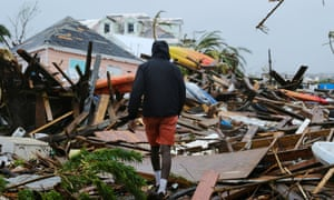 A man walks through the rubble in the aftermath of Hurricane Dorian on the Great Abaco island town of Marsh Harbour, Bahamas, 2 September 2019.