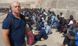 Ross Kemp with migrants back in port
