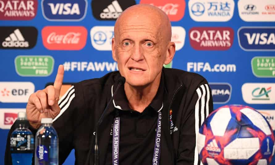 Pierluigi Collina gestures by raising a finger during a press conference in Paris