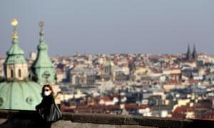 A woman wearing a face mask at Prague Castle