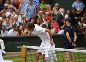 Marin Cilic hits his chair with his racket
