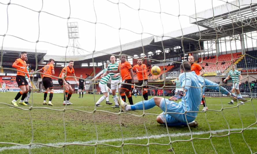 Dundee United goalkeeper Benjamin Siegrist makes a save to deny Celtic