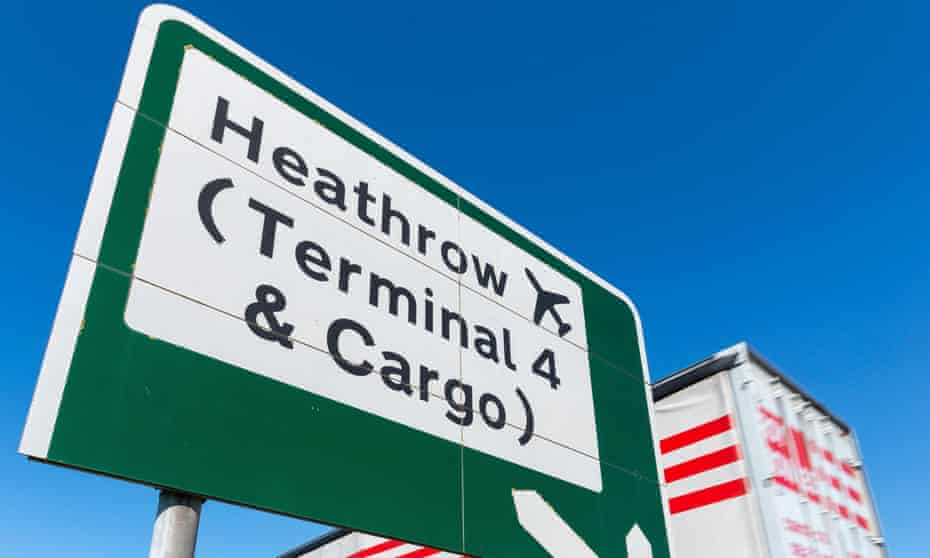 A goods vehicle passes a sign to Heathrow