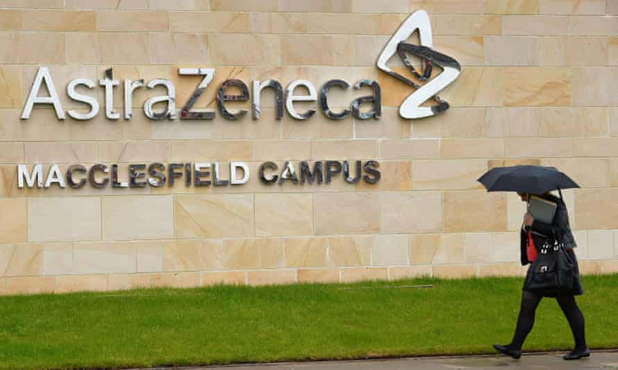 A woman walks outside British pharmaceutical company AstraZeneca in Macclesfield
