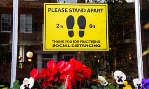 Social distancing sign in a shopfront.