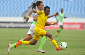 Thembi Kgatlana of South Africa surges past Nigeria's Onome Ebi during their Women's African Cup of Nations group match. The two teams meet again in the final.