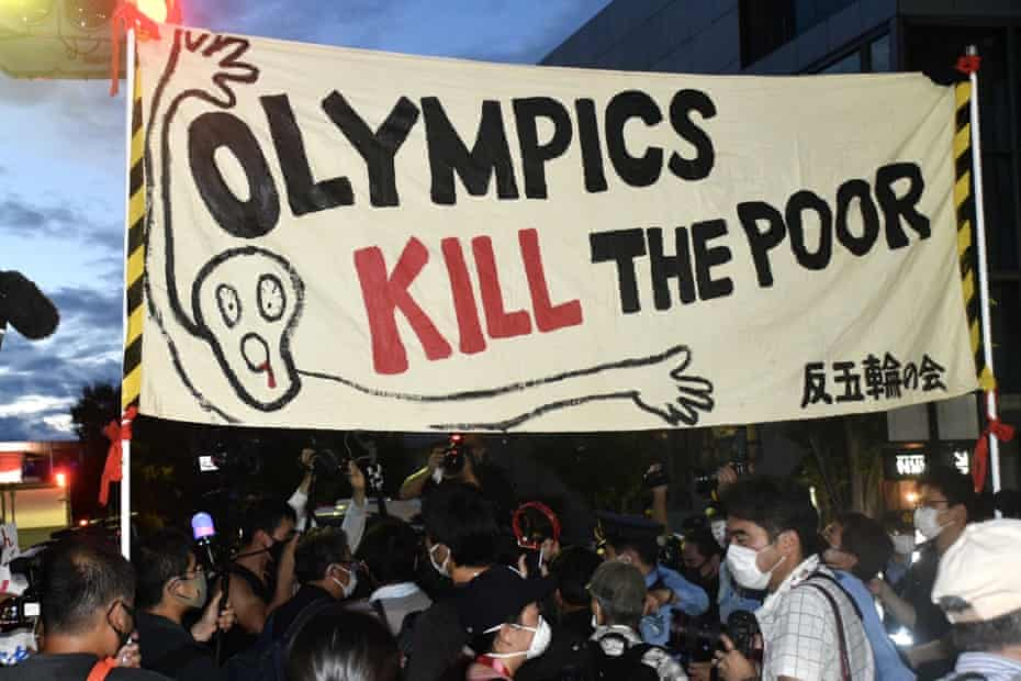 """A banner with a message """"Olympics Kill the Poor"""" is seen during a protest outside the Japan National Stadium (a.k.a the Olympic Stadium) before the closing ceremony of the 2020 Summer Olympic Games."""