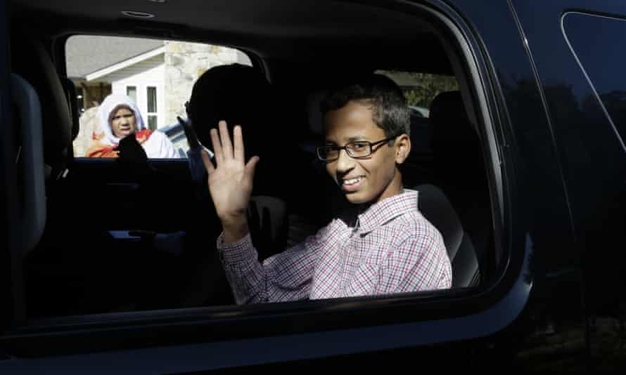 Ahmed Mohamed, 14, waves before leaving his family's home in Irving, Texas.