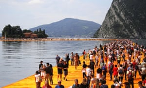 People walk on the monumental installation entitled 'the Floating Piers' created by artist Christo Vladimirov Javacheff on Lake Iseo in northern Italy.