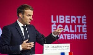 Emmanuel Macron gives a speech in front of the words 'Liberté, égalité, fraternité'