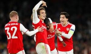 Arsenal's Nicolas Pepe celebrates scoring their third goal with teammates.