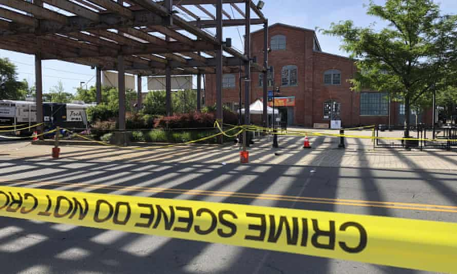 Police crime-scene tape keeps people away from the brick Roebling Wire Works building in Trenton.