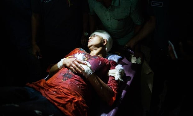 Avijit Roy's wife, Rafida Ahmed Banna, is carried on a stretcher after being seriously injured by unidentified assailants. Roy founded a blog site which champions liberal secular writing in the Muslim majority nation.