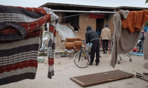 Migrant workers gather their belongings before the demolition of their makeshift settlement in Campobello di Mazara