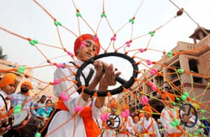 A boy performs Gatkha, a traditional form of martial arts, during a procession on the eve of the 550th anniversary of the birth of Guru Nanak Dev, the founder of the Sikh faith in Amritsar, India