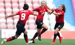 Millie Turner, centre, celebrates after giving Manchester United the lead against Aston Villa.