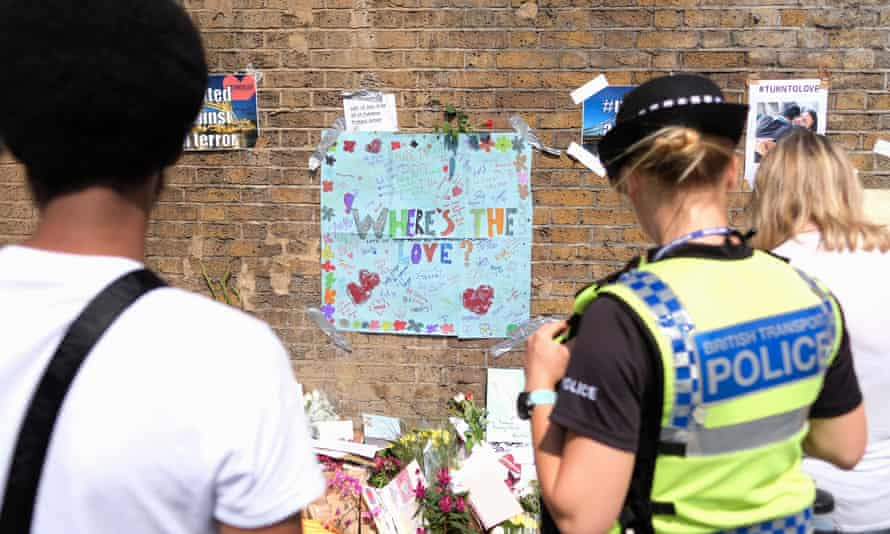People read messages of support for the Muslim community near Finsbury Park mosque.