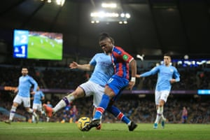 Wilfried Zaha of Palace puts the ball across the area and its diverted into the net by Fernandinho (not pictured) to scores Palace's second goal