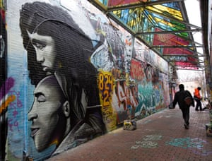 A mural depicting the father and daughter in 'Graffiti Alley' in Cambridge, Massachusetts.